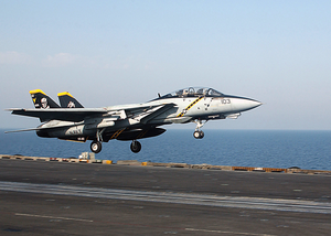 An F-14  Tomcat  From The  Jolly Rogers  Of Fighter Squadron One Zero Three (vf-103) Launches From The Waist Catapult Aboard Uss George Washington (cvn 73) Image