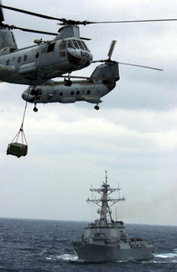 Two Ch-46d Sea Knight Helicopters Cross Paths While Transferring Cargo Image
