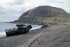 Amphibious Assault Vehicles (aavs) Line The Beach Below Mount Suribachi On The Island Of Iwo Jima Image