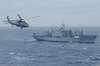 An Sh-60 Seahawk From Uss Kitty Hawk Flies Toward Usns Concord (t-afs 5) Image