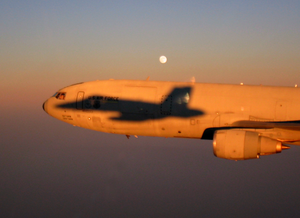 An F/a-18c Hornet Assigned To The Marauders Of Strike Fighter Squadron Eight Six (vfa-82) Casts Its Shadow Onto A U.s. Air Force Kc-10a Extender. Image
