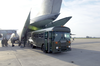 A Transport Bus From The U.s. Navy S Fleet Hospital Eight Backs Into The Tail Of A Waiting Air Force C-5 Galaxy Medical Evacuation (medevac) Plane. Image