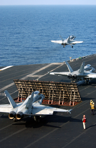 F/a-18 Hornets Assigned To Carrier Air Wing Three (cvw-3) Launch From The Flight Deck Of Uss Harry S. Truman (cvn 75). Image