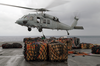 Storekeepers Assigned To The Aircraft Carrier Uss Kitty Hawk (cv 63) Supply Department S Stock Control Division, Hook Up Palletized Cargo To An Mh-60s Knighthawk Helicopter. Image