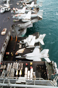 An S-3b  Viking  Aircraft And An F/a-18e  Super Hornet  Are Lowered From The Flight Deck To The Hangar Bay Image