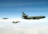 An F/a-18 And An F-14 Refuels With A U.s. Air Force Kc-135 Sratotanker Assigned To The 380th Aerial Refueling Wing Image