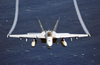 An F/a-18e Super Hornet Flies Over The Western Pacific Ocean During Flight Operations. Image