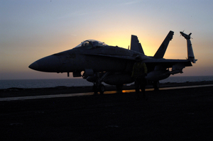 An F/a-18c Hornet Assigned To The  Eagles  Of Strike Fighter Squadron One One Five (vaw-115) Prepares To Launch From The Flight Deck Aboard The Aircraft Carrier Uss Abraham Lincoln (cvn 72) Image