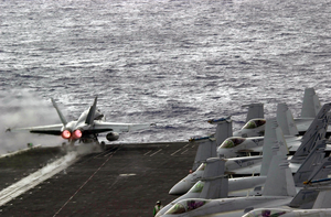 An Fa-18a Hornet  Launches From The Flight Deck. Image