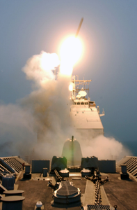A Tomahawk Land Attack Missile (tlam) Leaves The Deck Of The Guided Missile Cruiser Uss Bunker Hill (cg 52). Image