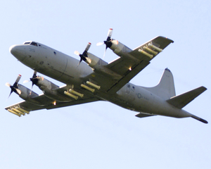 A P-3c  Orion  Attached To The  Tigers  Of Patrol Squadron Eight (vp-8) Heads To A Bombing Exercise Image