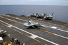 An F/a-18c Hornet Makes The First Arrested Landing Following A Recently Applied Non-skid Landing Area In Apra Harbor, Guam Image