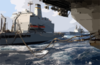 Uss Kitty Hawk (cv 63) Receives Fuel From The Military Sealift Command (msc) Replenishment Oilier Usns Rappahannock (t-ao 204) While The Destroyer Uss Paul F. Foster (dd 964) Approaches From The Rear. Clip Art