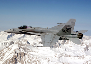An F/a-18c Hornet Flies Over The Sierra Nevada Mountains During A Routine Training Flight Image