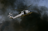 Black Smoke Clouds Rise From A Pyrotechnic Display As An Hh-60h Seahawk Helicopter Demonstrates Combat Search And Rescue (csar) For The Audience Attending The Blue Angels Homecoming Air Show At Nas Pensacola. Image