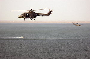 A British Royal Navy Gkn Westland Lynx Hma Mk. 8 Helicopter Acts As Plane Guard For An Mh-53 Sea Dragon Helicopter Assigned To The  Vanguards  Of Helicopter Mine Countermeasures Squadron Fourteen (hm-14). Image