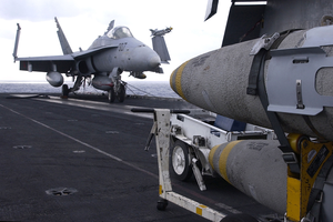 An F/a-18 Hornet Is Tied Down On The Bow Of The Flight Deck Aboard The Aircraft Carrier Uss Harry S. Truman (cvn 75). Image
