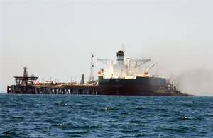 Commercial Oil Tanker Abqaiq Is Helped Into Position By Tugboats Prior To Receiving Crude Oil Image