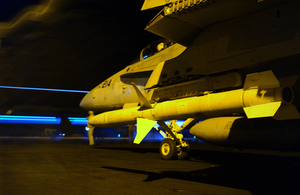A High Speed Anti-radiation Missile (harm) Is Positioned On An F/a-18c Hornet During Night Flight Operations Aboard Uss Kitty Hawk (cv 63). Image