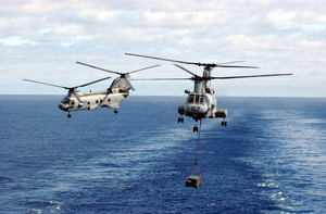 Helicopter Transfer Crates Of Supplies From Aboard Uss Sacramento Image