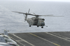 An Mh-53e Sea Dragon Assigned To The Blackhawks Of Helicopter Mine-counter-measures Squadron 15 (hm-15) Lands Aboard Uss Nimitz (cvn 68) Image