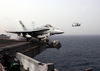 An F/a-18c Hornet Assigned To The  Stingers  Of Strike Fighter Squadron One One Three (vfa 113) Launches From The Flight Deck Aboard The Aircraft Carrier Uss Abraham Lincoln (cvn 72). Image