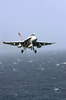 A F/a-18e/f Super Hornet Comes In For An Arrested Landing On The Flight Deck Of The Nuclear Powered Aircraft Carrier Uss Nimitz (cvn 68). Image