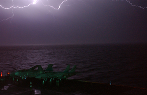 Lightning Fills The Evening Sky Aboard Uss Constellation (cv 64). Image