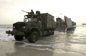 A 5-ton Truck Roles Off Of A Landing Craft Utility (lcu) From The Uss Tarawa Amphibious (lha 1) Ready Group (arg) To Be Used For Future Operations. Image