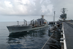 The Military Sea Lift Command, Oiler Usns Kanawha (t-ao 196) Comes Along Side Uss Theodore Roosevelt (cvn 71) For An Underway Replenishment Image