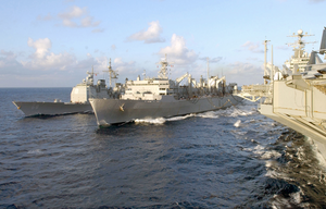 Uss Anzio (cg 68) Conducts An Underway Replenishment (unrep) At Sea Off The Starboard Side Of The Military Sealift Command Oiler Usns Arctic (t-aoe 8), While Theodore Roosevelt Conducts A Simultaneous Replenishment Image