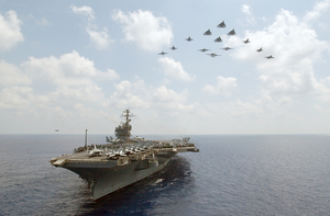Elements From Carrier Air Wing Seven (cvw-7) Conduct A  Fly-over  Above Uss John F. Kennedy (cv 67) Image