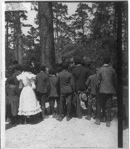 [theodore Roosevelt Standing In A Wooded Area, Speaking To Group Of African American Children] Image