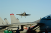 An F/a-18c Hornet Flies Over The Flight Deck Of Uss George Washington (cvn 73) Image