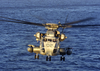 A Ch-53e Flies Over The Atlantic Ocean At Sunrise During Deck Landing Qualification Image