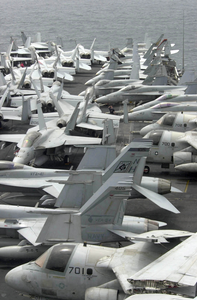 On The Flight Deck Of Uss Nimitz (cvn 68) Carrier Air Wing Eleven (cvw-11) Aircraft Are Strategically Parked During A Scheduled No Fly Day Image
