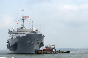 Tugboats Assist The Amphibious Command And Control Ship Uss Mount Whitney (lcc/jcc 20) To The Pier. Image