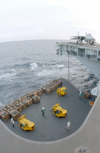 Supplies Are Loaded On To One Of Four Aircraft Elevators During A Replenishment At Sea Image
