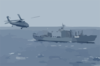 An Sh-60 Seahawk From Uss Kitty Hawk Flies Toward Usns Concord (t-afs 5) Clip Art