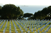 A Tugboat Tows The Decommissioned Aircraft Carrier Midway Past Fort Rosecrans National Cemetery To San Diego Bay. Image