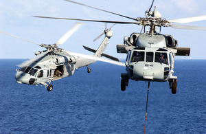 Two Mh-60s Knighthawk Helicopters Assigned To The  Providers  Of Helicopter Composite Squadron Five (hc-5) Pass One Another During A Replenishment Detail With Uss Kitty Hawk (cv 63) Image