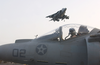 An Av-8b Harrier Begins Its Vertical Landing Aboard Uss Bonhomme Richard (lhd 6) Image