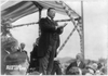 [theodore Roosevelt, Full Length Portrait, Turned Right,  Standing Above Crowd He Is Addressing] Image