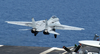 An F-14d Tomcat Launches From The Flight Deck Aboard Uss Theodore Roosevelt (cvn 71) Image