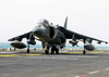 An Av-8 Harrier Taxis To The Ready Position Prior To Launching From The Flight Deck Of The Uss Bataan (lhd 5) In Support Of Operation Iraqi Freedom Image