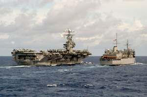 The Nuclear-powered Aircraft Carrier Uss Carl Vinson (cvn 70) And Fast Combat Support Ship Uss Sacramento (aoe 1) Engage In An Underway Replenishment (unreps) Image