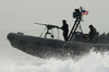 Naval Special Warfare Combatant-craft Crewmen Operate A Rigid Hull Inflatable Boat Image