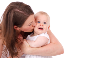 Mother Kissing Baby T Image