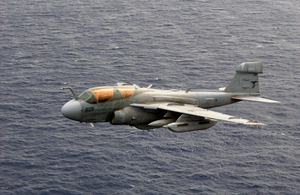 An Ea-6b Prowler Assigned To The Black Ravens Of Electronic Attack Squadron One Thirty Five (vaq-135) Flies Over The Western Pacific Ocean Image