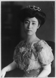 Lady Sitting Wearing Crown Image
